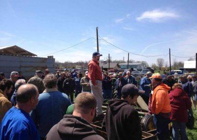 Auctioneer selling farm equipment