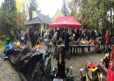 Auction taking place in rain